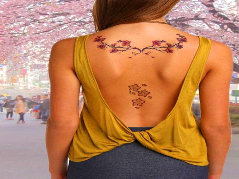 tatuajes mujer - tattoo en la espalda